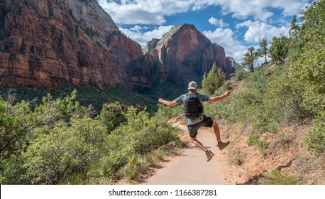ZION NATIONAL PARK, UTAH/USA 6/15/18: Young mans summiting to the top of Angels Landing of Zion National Park.