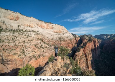 ZION NATIONAL PARK, UTAH/USA 6/15/18: Young man summiting to the top of Angels Landing of Zion National Park.