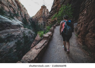 ZION NATIONAL PARK, UTAH/USA 6/15/18: Yong female summiting to the top of Angels Landing, Zion National Park.
