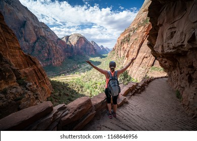ZION NATIONAL PARK, UTAH/USA 6/15/18: Young women reflects on her goal of getting to the top of Angels Landing, Zion National Park.