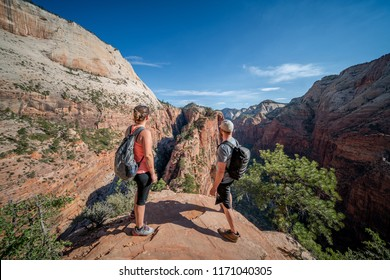 ZION NATIONAL PARK, UTAH/USA 6/15/18: Couple look in amazment at the task they just accomplished. Climb to top of Angels Landing, Zion National Park.