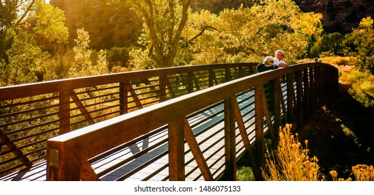 Zion NP, Utah - 10/26/2009: Tourists on a Bridge accross the Virgin River in Zion National Park during the fall season.