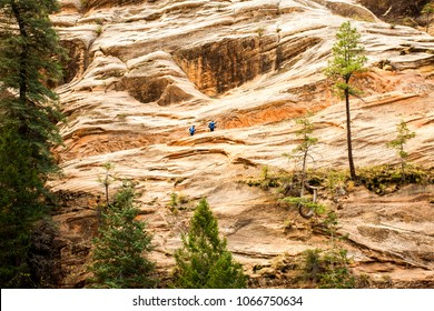 Zion, Utah - 10/28/2009:  Hikers on the Hidden Canyon trail in Zion National Park, Utah