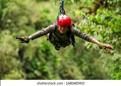 zip line zipline canopy action wire gliding hang adventure rainforest travel woman zipline exploration in ecuadorian rainforest banos de agua santa zip line zipline canopy action wire gliding hang adv