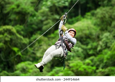 zip line zipline wire canopy people normal rope jungle sport climbing grown pioneer wearing casual clothing on zipline trip selective stress against blurred forestry zip line zipline wire canopy peopl
