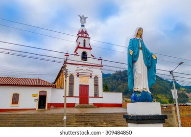 ZIPAQUIRA, COLOMBIA - FEBRUARY 3, 2015: Virgin statue with blue cape guarding church building from historic city Zipaquira, located in the middle of Colombia.