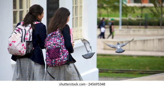 ZIPAQUIRA, COLOMBIA - MAY 7, 2014: Two school girls walking through the streets of Zipaquira. Colombia developed the method of teaching known as Escuela Nueva or New School.