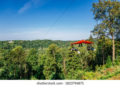 Zipline adventure activity for Cablecar Sigulda to Cablecar Krimulda with green forest mountain in Sigulda, Latvia