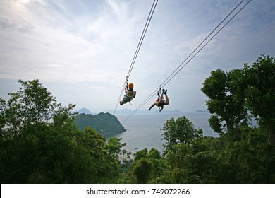 Ziplining on a zip wire connecting Las Cabanas beach in El Nido and Depeldet Island, on Palawan, The Philippines