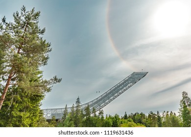 Ziplining on a zip wire in Oslo from top of Holmenkollen ski jump. Bright Circle around the Sun. Norway