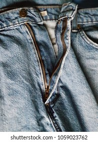 Zipper on a pair of jeans.