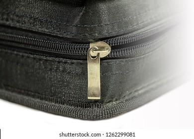 zipper opens in the textile box. zipper box.  Empty  zipper bag. Zipper fabric. illumination on the right.