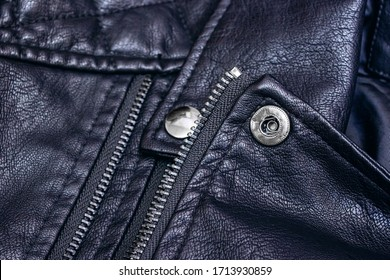 Zipper and rivets on black leather clothes