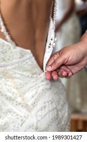 Zipping up a wedding dress
