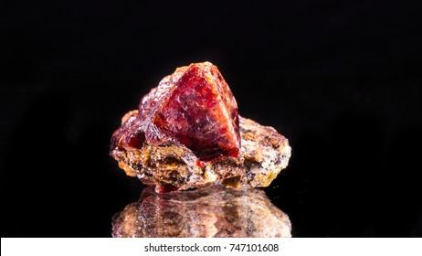 Zircon crystal on black background