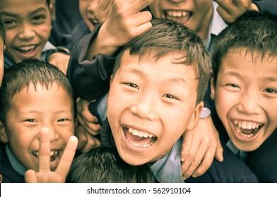 Ziro, Arunachal Pradesh - circa March 2012: Young boys in school uniforms smile joyfully to photocamera in Ziro, Arunachal Pradesh. Documentary editorial.