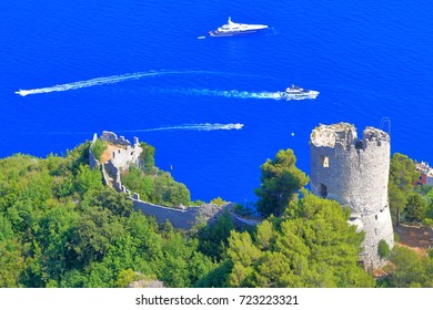 Ziro tower surrounded by vegetation above the sea on Amalfi coast, Italy