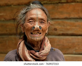 Ziro Valley, Arunachal Pradesh, Northeast India - Oct 24, 2017: Old Apatani tribal woman with black wooden nose plugs and tribal face tattoo, on Oct 24, 2017.