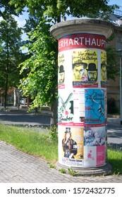ZITTAU, GERMANY - JUNE 9, 2019 :  Theater advertising column in Zittau, Germany.