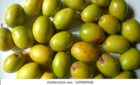 Ziziphus Mauritiana Fruits, Also Known as Chinese Date, Ber, Chinee Apple, Jujube, Indian Plum, Regi Pandu, Indian Jujube, Dunks (in Barbados) and Masau on White Dish Background