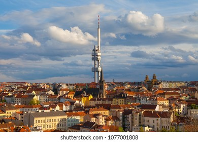 Zizkov Television Tower (circa 1992) in Prague and roof top view of dwellings around tower. Sunset time