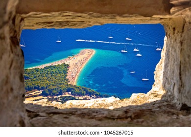 Zlatni rat beach aerial view through stone window, Island of Brac, Dalmatia, Croatia