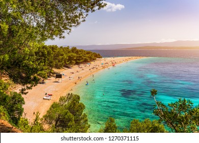 Zlatni Rat (Golden Cape or Golden Horn) famous turquoise beach in Bol town on Brac island, Dalmatia, Croatia. Zlatni Rat sandy beach at Bol on Brac island of Croatia in summertime.