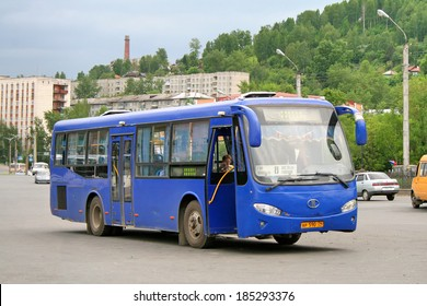 ZLATOUST, RUSSIA - JUNE 12, 2009: Blue Mudan MD6106 city bus at the city street.