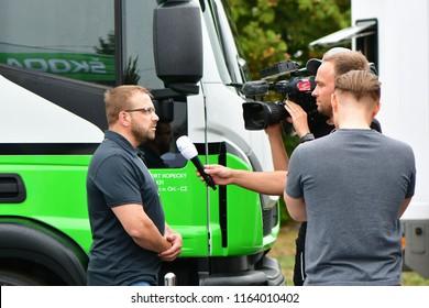 ZLIN, CZECH REP. - AUGUST 25 : interview in service zone in town Otrokovice during Barum Czech Rally August 25, 2018 in Zlin, Czech Republic.