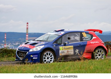 ZLIN, CZECH REP. - AUGUST 26 : Driver Pellier Laurentand co driver Combe Geoffrey in Peugeot 208 T16 R5 at speed stage no.10 during Barum Czech Rally August 26, 2018 in Zlin, Czech Republic.