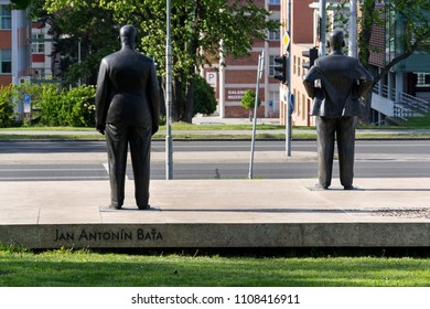 ZLIN, CZECH REPUBLIC - APRIL 29 2018: Tomas and Jan Antonin Bata statue across street from Batas skyscraper 21 on April 29, 2018 in Zlin, Czech Republic.