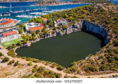 Zmajevo Oko or Dragon Eye Lake near Rogoznica from above. Aerial drone shot, september 2020 - Shutterstock ID 1916759207