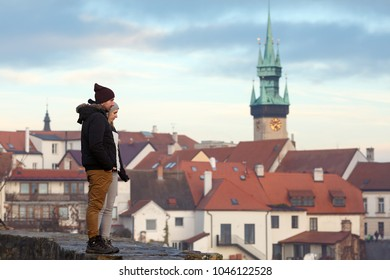 ZNOJMO, CZECH REPUBLIC - DE?EMBER 28, 2017. Young couple on background of the old town of Znojmo. View of the Town Hall Tower. Znojmo, Chech Republic, Europe.