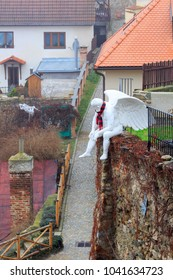 ZNOJMO/ CZECH REPUBLIC - DECEMBER 28, 2017. Aerial view of the historical downtown of Znojmo. Sculpture of the winged man sitting on a wall. Znojmo, Czech Republic, Europe.