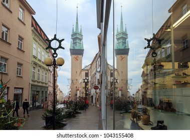ZNOJMO, CZECH REPUBLIC - DECEMBER 28, 2017. Town Hall Tower is reflected in a shop window during Christmas holiday. Historical centre of Znojmo, Czech Republic, Europe.