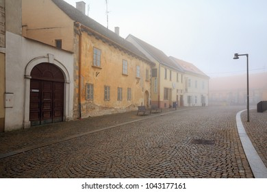 ZNOJMO, CZECH REPUBLIC - DECEMBER 28, 2017. Old cobbled street in the historical downtown on a foggy winter day. Znojmo, Czech Republic, Europe
