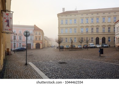 ZNOJMO, CZECH REPUBLIC - DECEMBER 28, 2017. Wenceslas Square in the old town of Znojmo on a foggy winter day. View of the Elementary School building. Znojmo, Czech Republic, Europe.