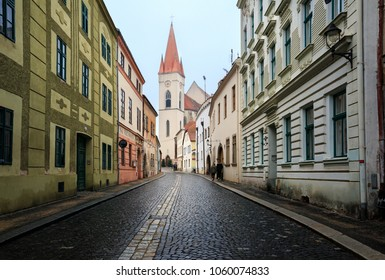 ZNOJMO, CZECH REPUBLIC - DECEMBER 28, 2017. Old cobblestoned street in the historical downtown on a winter day. View of the St. Nicholas Church . Town of Znojmo, Czech Republic, South Moravia, Europe