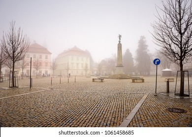 ZNOJMO, CZECH REPUBLIC - DECEMBER 28, 2017. Monument dedicated to the victory in the Austro-Sardinian war of 1848-1849 on the Komenskeho square on a foggy winter day. Znojmo, Moravia, Czech Republic