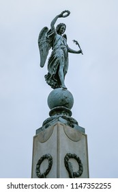 ZNOJMO, CZECHIA – SEPTEMBER 20 2013: Elegant bronze statue of Nike, the Greek Goddess of Victory, originally a memorial for Karl Kopal, on a granite obelisk; cultural monument of the Czech Republic.