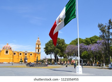 The Zocalo in Cholula Mexico with the flag