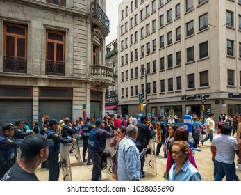 ZOCALO, MEXICO CITY-July 28, 2016. People walking around Zocalo's retail district while Mexican Federal Police are on standby.