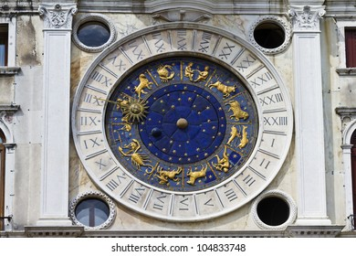 Zodiac clock. Clock Tower with winged lion and two moors striking the bell - early Renaissance (1497) building in Venice, located the north side of Piazza San Marco, Italy, Europe.