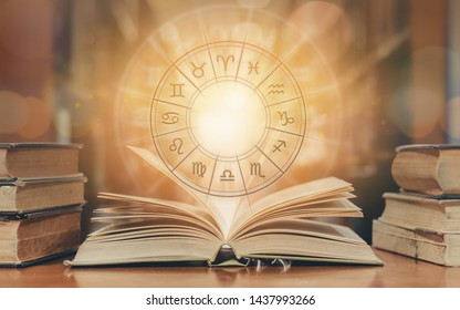 Zodiac sign horoscope astrology and constellation study for foretell and fortune telling education course concept with horoscopic wheel over old book in school library