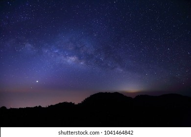 Zodiacal light The Panorama Milky way galaxy with stars and space dust in the universe, Long exposure photograph, with grain.foreground summit tropical forest , thailand