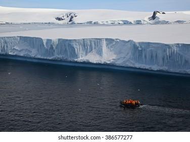 Zodiacs near tabular iceberg in Hope Bay, Antarctica (near Esperanza Base on the Antarctic Peninsula)