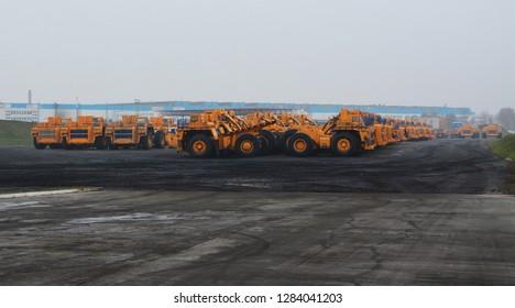 Zodzina, Belarus - November 2, 2015: Huge haul yellow colored trucks by belarusian manufacturer Belaz in Zodzina, Belarus.