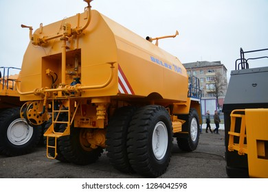 Zodzina, Belarus - November 2, 2015: Yellow colored truck by belarusian manufacturer Belaz in Zodzina, Belarus.