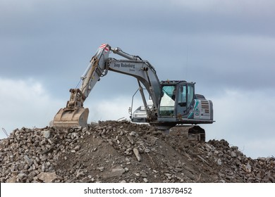 Zoetermeer, Netherlands - April 30 2020: Excavator clearing building rubble for removal from site.