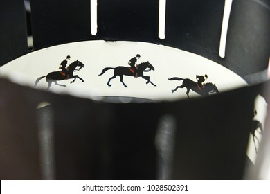 A zoetrope is one of several pre-film animation devices that produce the illusion of motion by displaying a sequence of drawings. Illustrative editorial photo